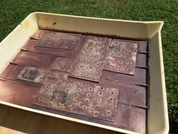 tray of galvanized steel rusting in the sun