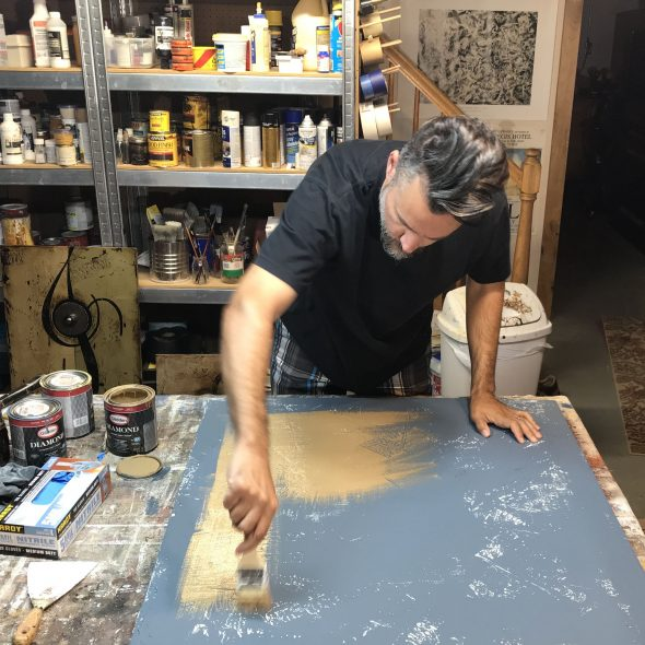 Artist Domenick Naccarato working in his home studio in Allentown, PA
